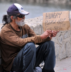 bigstock-Asking-for-help--a-homeless-m-28914638 cropped.jpg