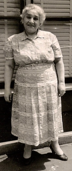 Sitti standing alone outdoors print dress